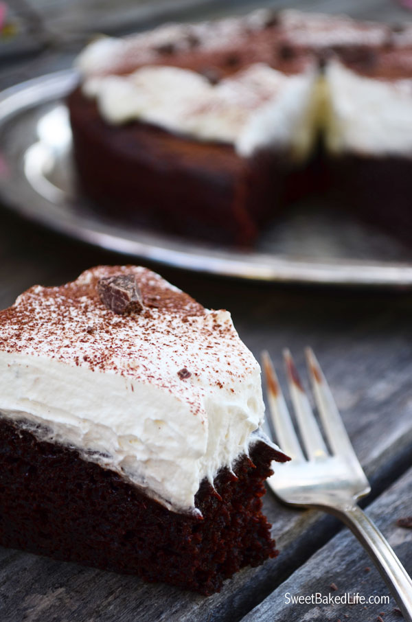 Bailey's Irish Cream Chocolate Cake includes a one-layer Bailey's chocolate cake, topped with Bailey's ganache and slathered with Bailey's whipped cream! | Sweet Baked Life