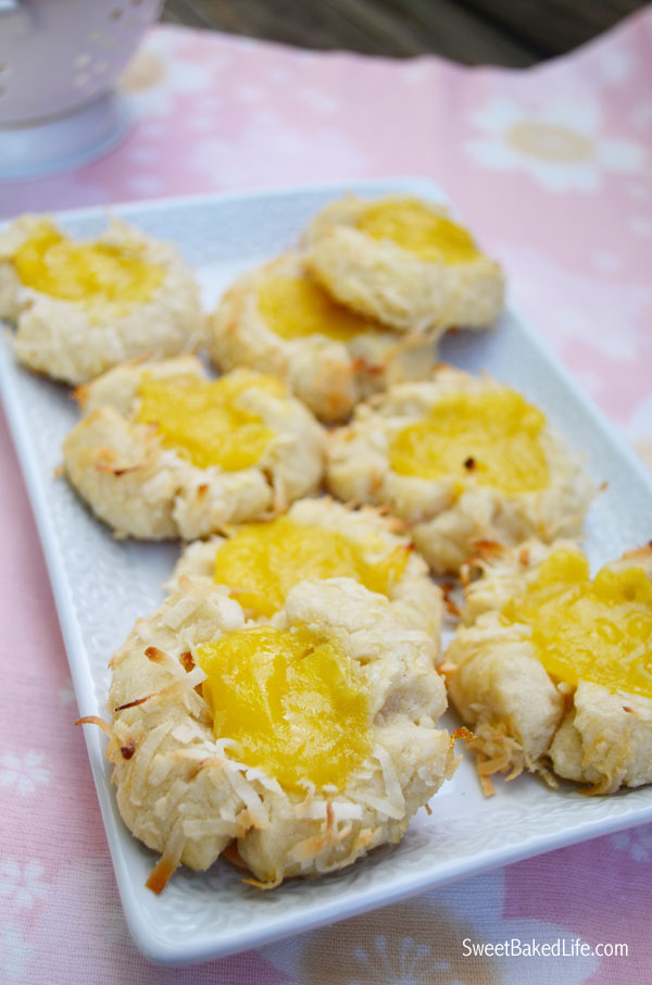 Jump into spring with these tasty Lemon Coconut Thumprint Cookies. Includes a simple homemade lemon curd recipe too! | Sweet Baked Life