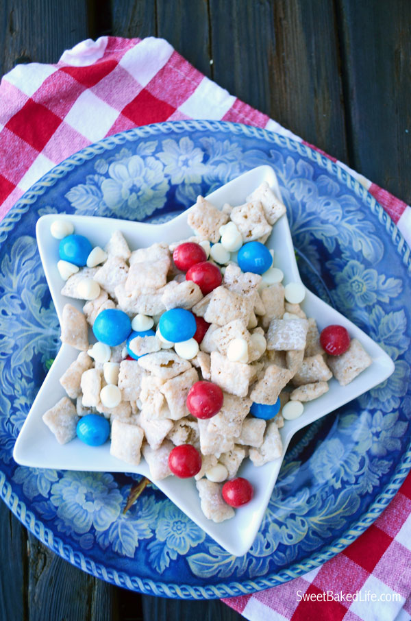 Patriotic Puppy Chow -- chex cereal coated with cake mix and sprinkled with red, white and blue candy. | Sweet Baked Life