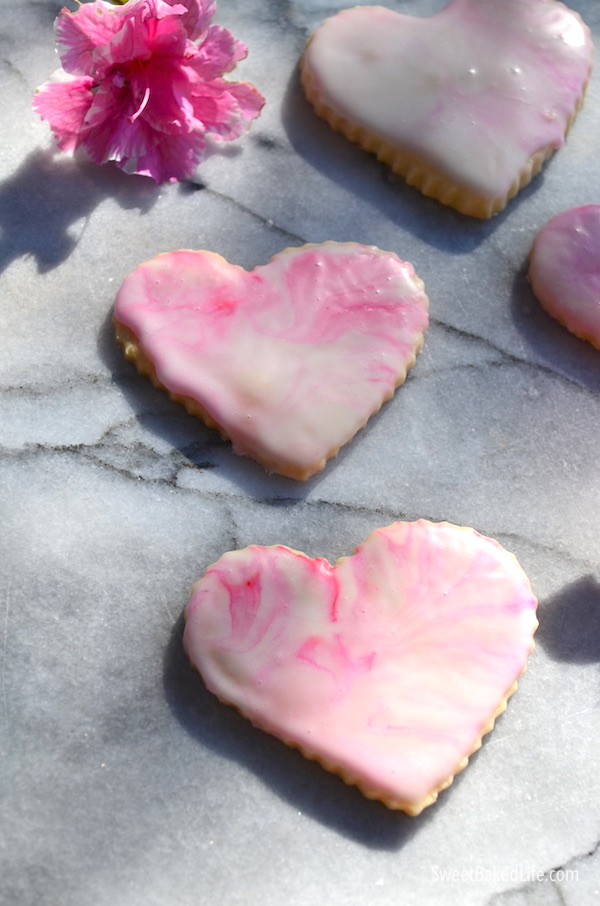 Pretty and delicious - pink glazed heart shortbread cookies | @sweetbakedlife.com