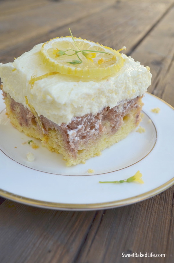 Lemon Raspberry Cake with tangy lemon buttercream frosting! @sweetbakedlife.com