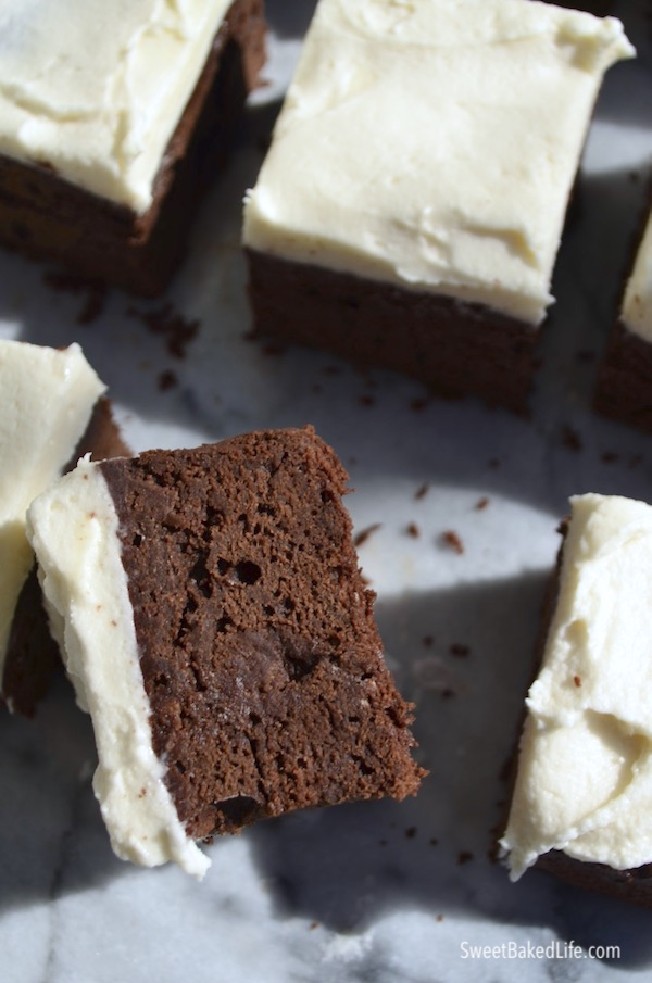 A cold chocolate snacking cake with creamy frosting both infused with the flavors of Baileys Irish cream. @sweetbakedlife
